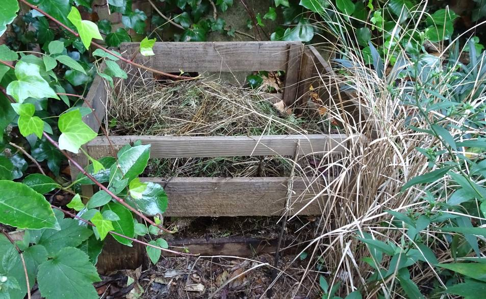 A wildlfie compost heap in a quiet corner of a garden.