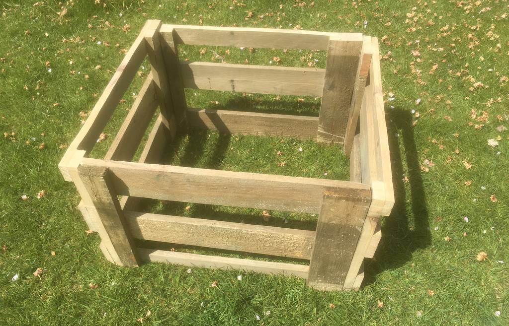 A homemade wooded compost frame.