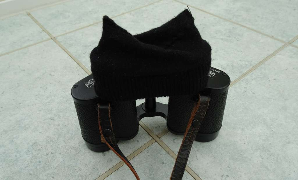 Here's a set of homemade, sock-based, lens covers on a vintage pair of Jena Jenoptems.
